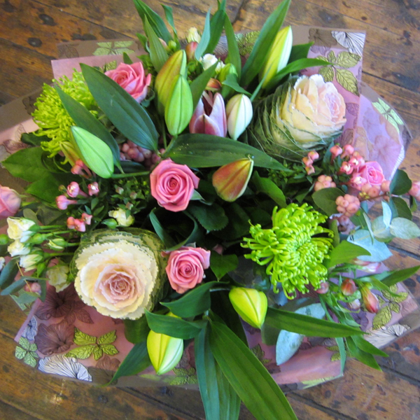 Hand-tied bouquet of lilies and pink roses