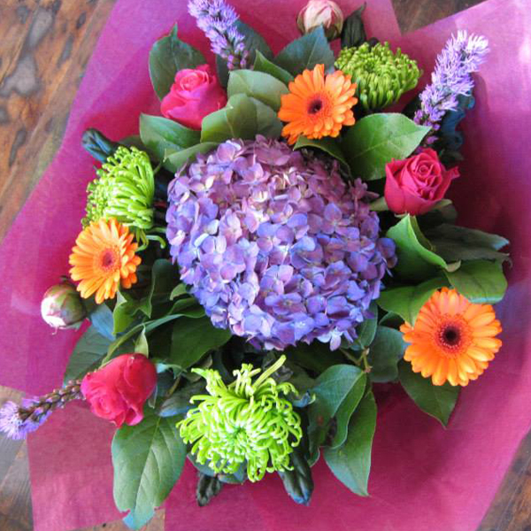 Bright and vibrant flowers, gerberas and roses with lime green blooms