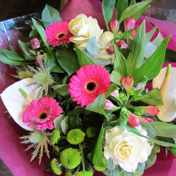 Cerise pink and white flower bouquet with thisle, anthuriums and alstromeria