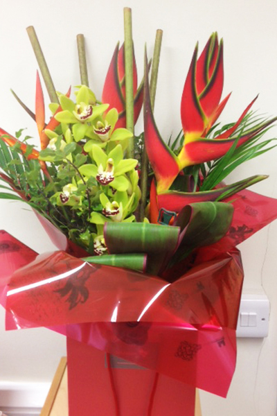 Exotic heliconia bouquet with orchids