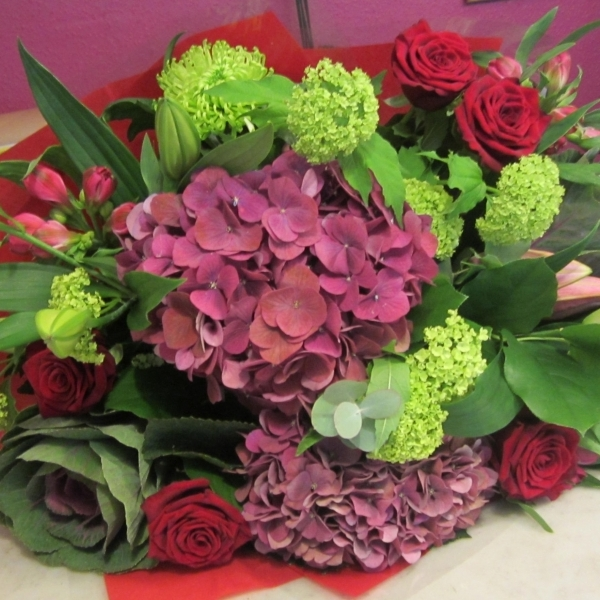 romantic bouquet of hydrangeas and red roses