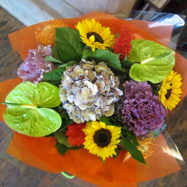 Sunny bunch of flowers including sunflowers and brassica