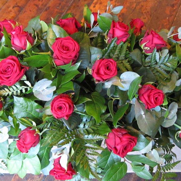 Coffin spray red roses and foliage large