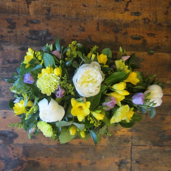 Tear drop shaped funeral tribute including freesia