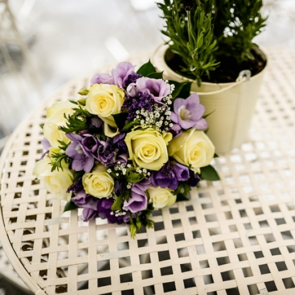 Bridal bouquet of lilac freesia, white avalanche roses and gypsophila