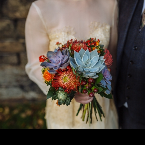 Bridal bouquet, succulents, berries, protea, autumnal wedding