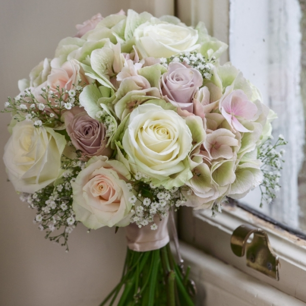 Elegant bridal bouquet of Roses and hydrangea, soft pinks and creams, vintage look