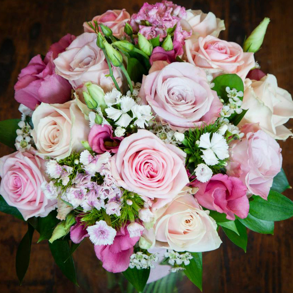Summer bouquet of Roses, lisianthus, sweet william in shades of pink